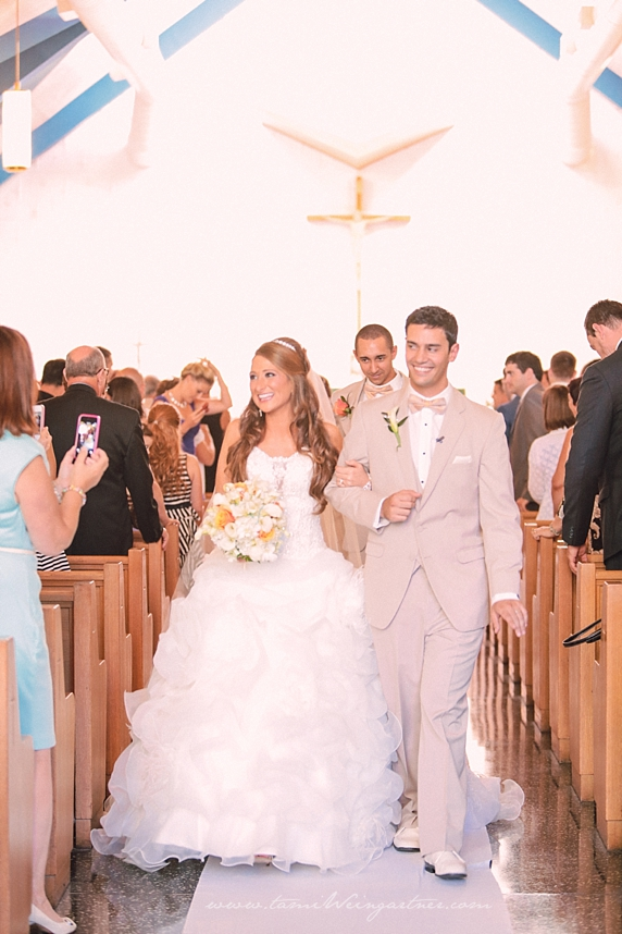 Happy couple walking back down the aisle at St. Anthony's Catholic Church in Bessemer PA.