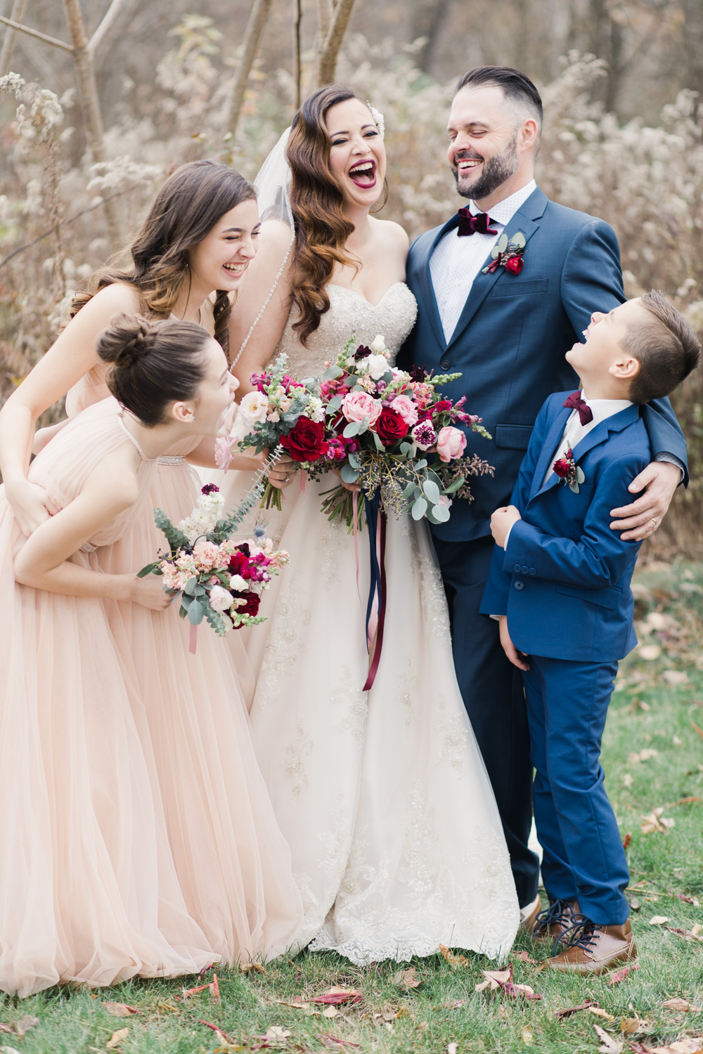 Couple and family having fun during wedding day portraits. Beautifully composed images is compelling.