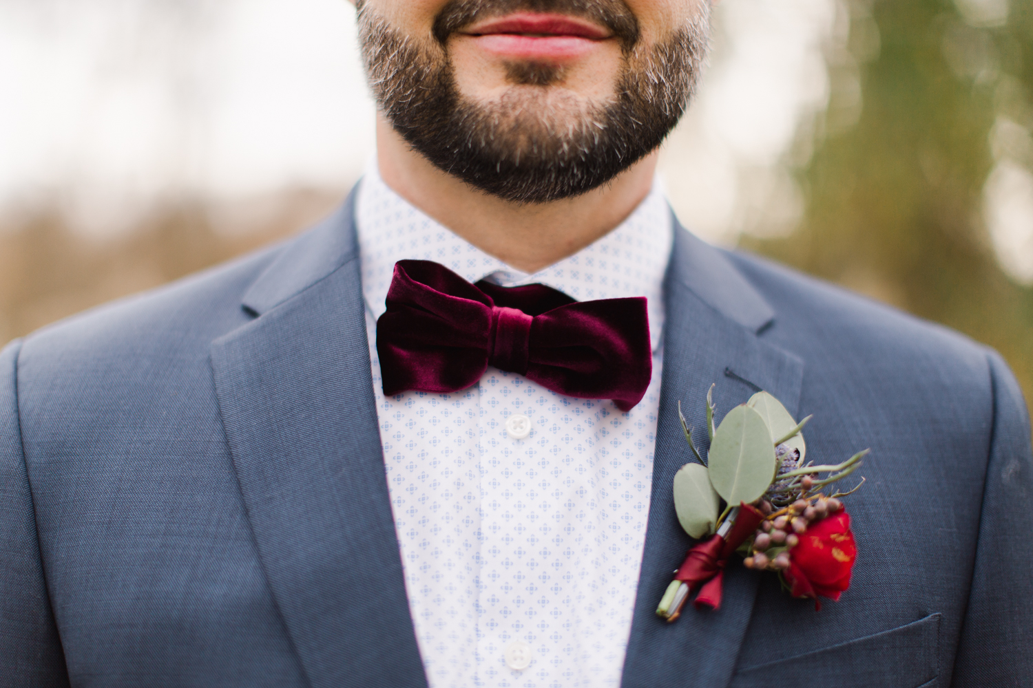 Grooms Details with patterned shirt and velvet bow tie.