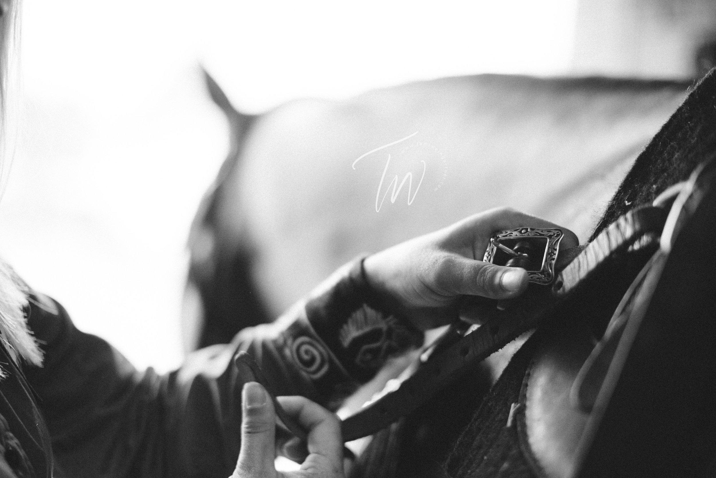 Breast collar buckle up on barrel saddle.