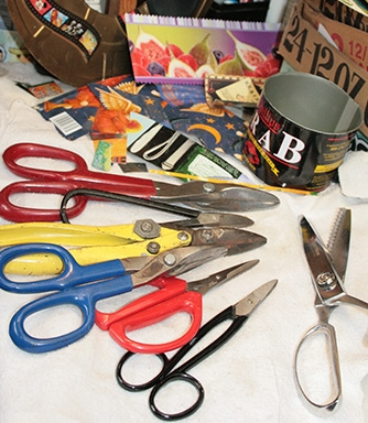 Cutting tin cans   Tin cans are usually cut by hand with metal cutting shears shown  above .If I am cutting larger cans or straight lines it is faster to use the step shear s hown below.