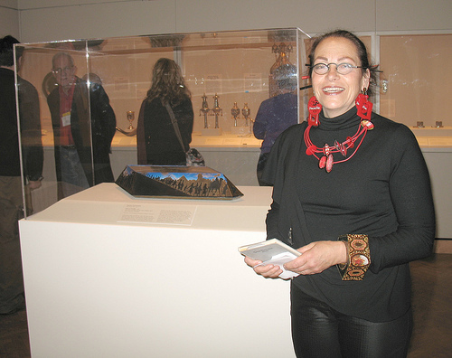 Harriete at the Minneapolis Institute of Art standing in front of her Seder plate Eons of Exodus.