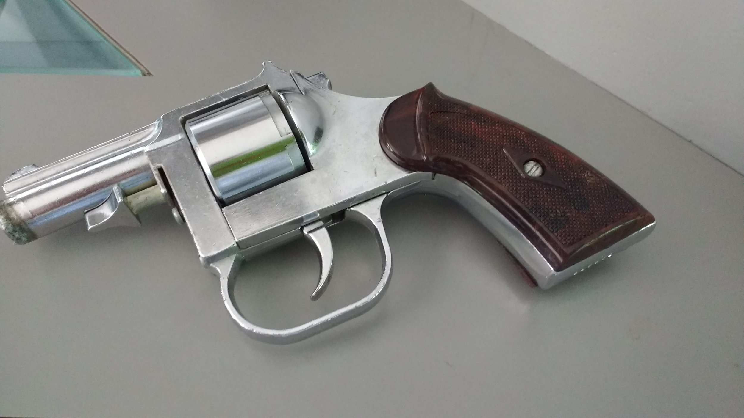 Gun from buy back program given to the artist for artwork about gun violence.
