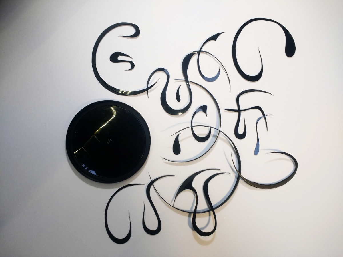 NOSA Yogurt container cut into tentacles for a black plastic gyre necklace boa.