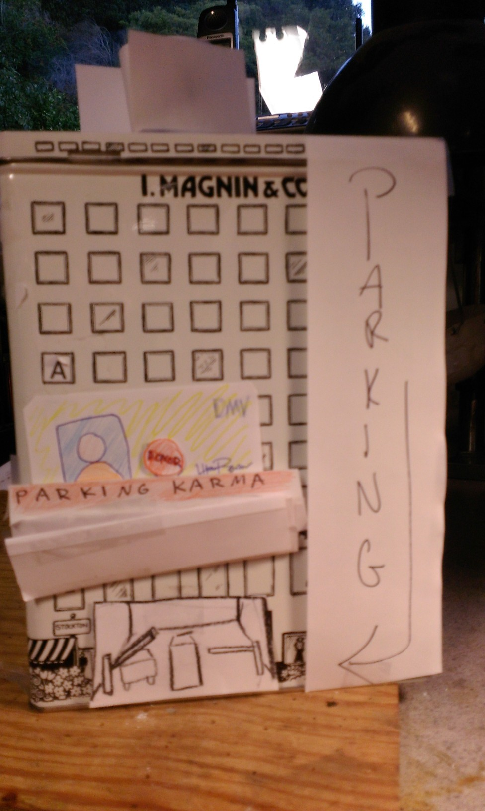 Parking Karma sketch and parking sign all in paper