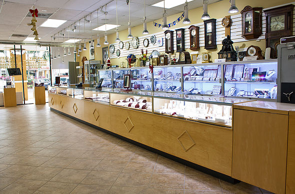 Our showroom floor at 5438 West Sample Road in Margate, Florida.   Browse watches, necklaces, rings, clocks, pendants, earrings and more.
