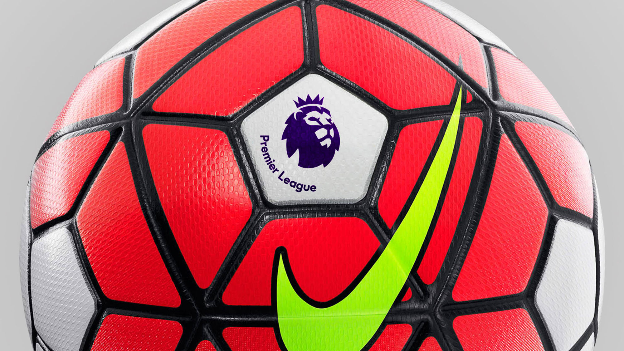 New branding upon the official Premier League match ball .