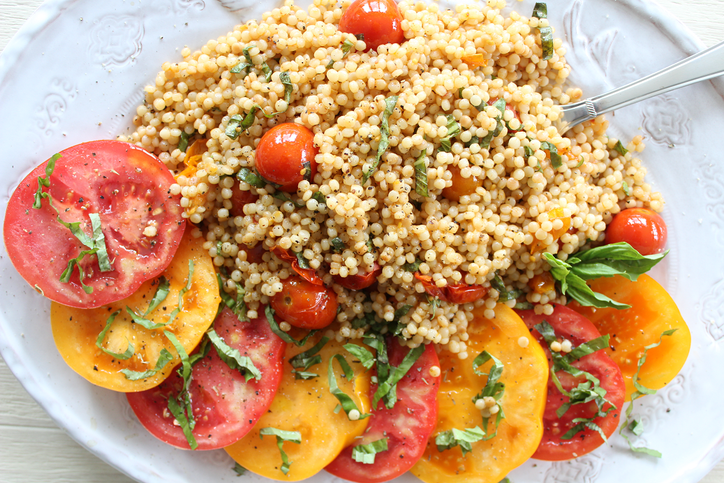 Roasted Tomato Couscous Salad pairs perfectly with big slices of heirloom tomatoes, dressed with olive oil and fresh basil. Serve for lunch, a light dinner, or as a stunning addition to brunch with family and friends!