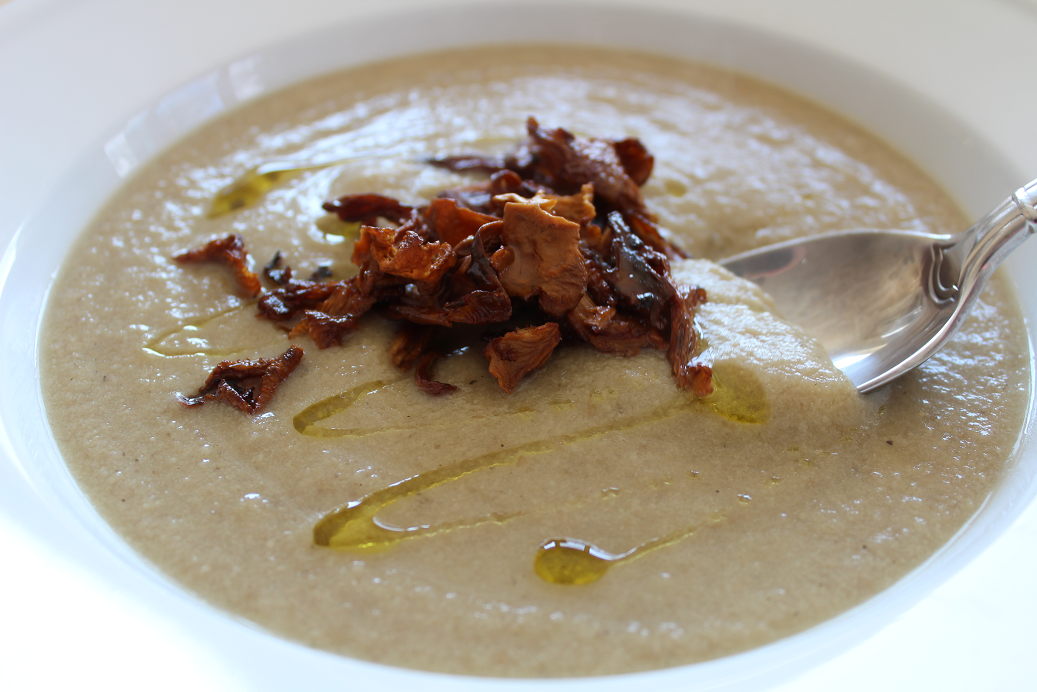Creamy Mushroom Soup (Vegan) tastes like pure comfort food but is loaded with veggies and has no cream or half-and-half! It's as easy as cooking onion, mushrooms, and potatoes in broth and blending until smooth with nondairy milk. The chanterelle mushrooms add both elegance and a peppery, earthy flavor.