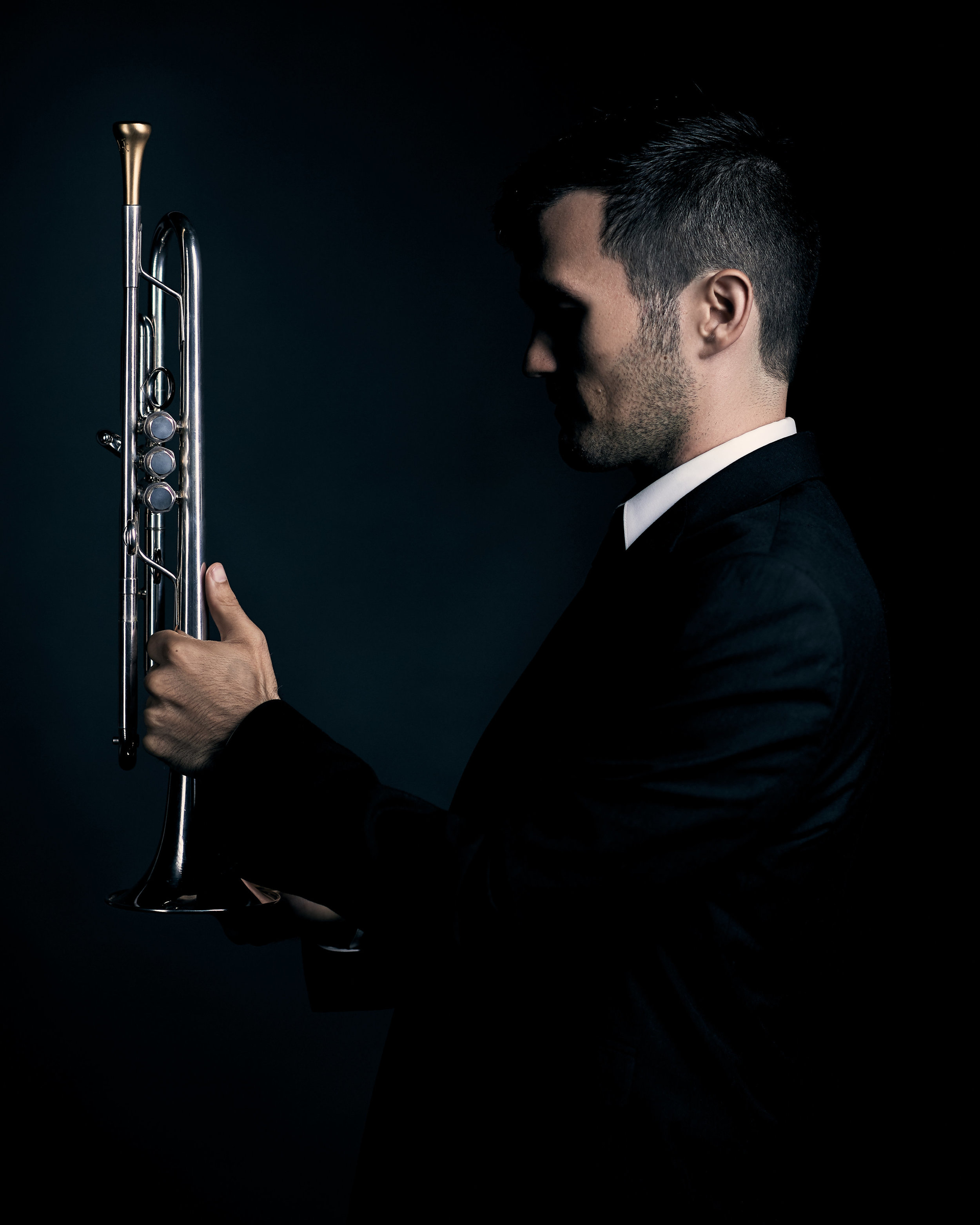 the first trumpet has two duties first is to bring an ensemble together through the democracies: time and tambre and second to bring fire to the one-mind that happens when all ears are open and musicians breathe and sing together