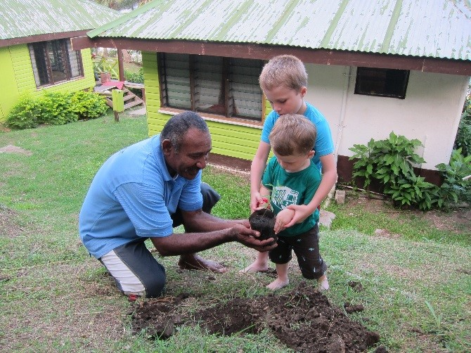 My kids planting sandalwood trees at Naqalia Lodge in Fiji so that we will come back to visit the trees as they grow.