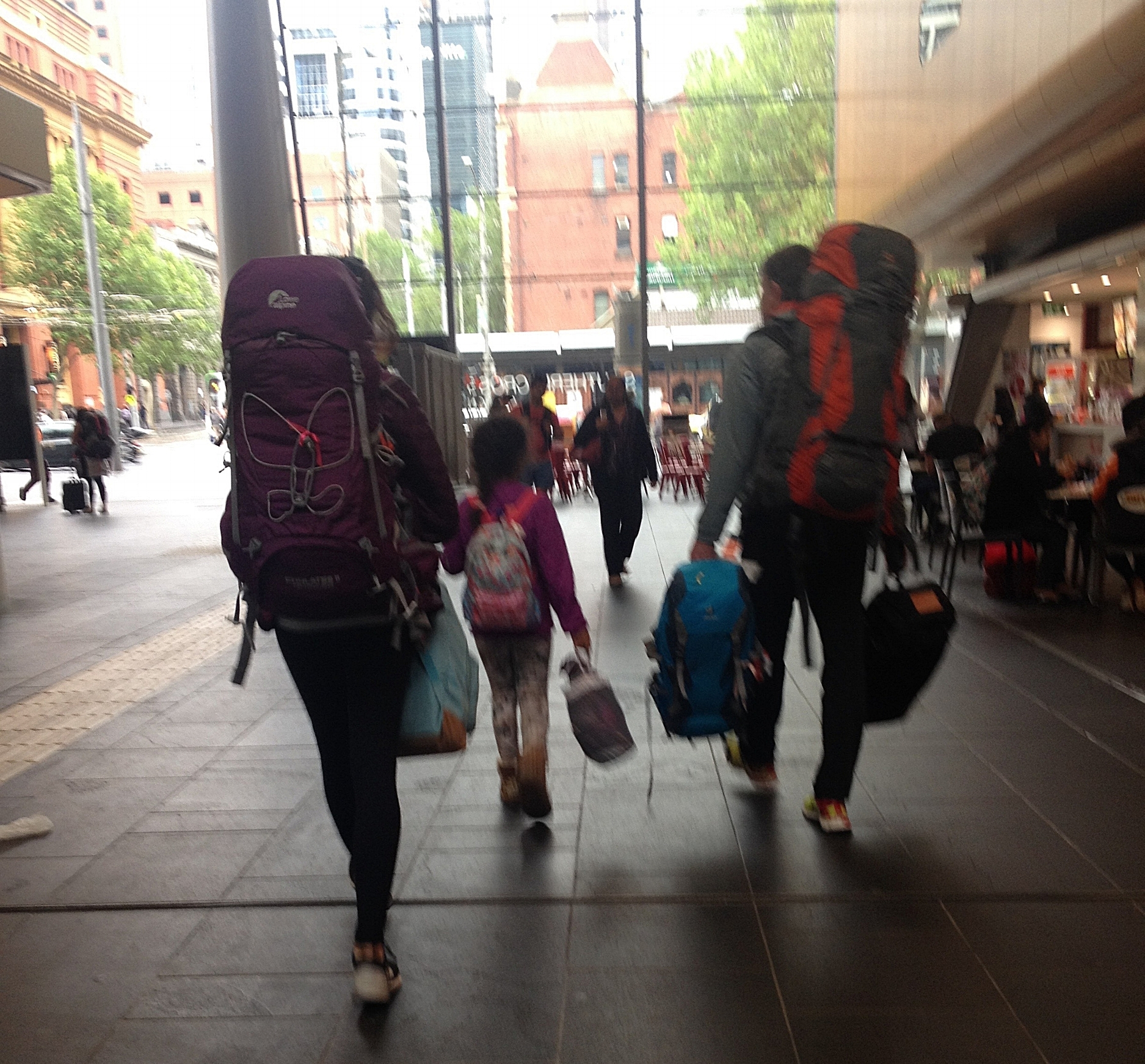 A blurry photo walking out of a train station in Melbourne. We all had one big and one smaller bag pack. (Zoe clearly convinced her father to carry her big bag...) I still like it - it shows exactly how it was at that moment.