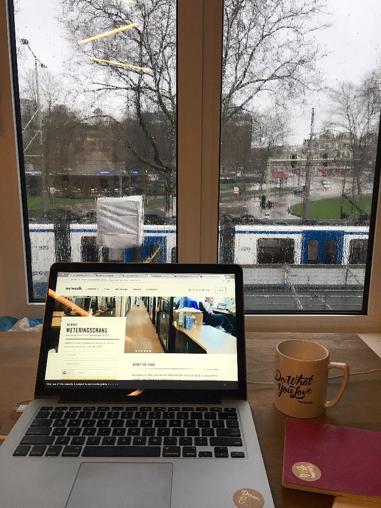 ~working from    We Work Amsterdam    was great (yep, typical Dutch weather with rain swept windows...)