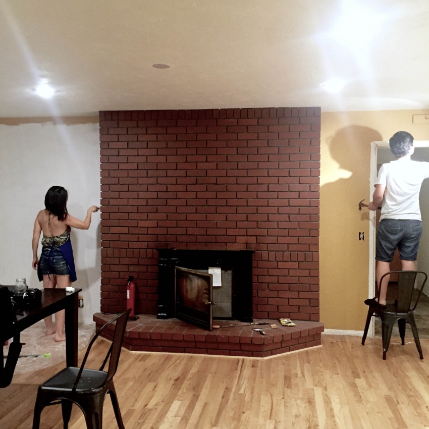 """We Started by Painting the wall   white,   since our shiplap will be white. ( NOTE : the small cracks between each plank will be showing the color of your wall.) After we painted, we measured the wall(s) to determine   how many sheets of hardwood plywood you'll need.     {     TIP:     We went to   home depot   because we knew they'd be able to cut each sheet into 6"""" strips for free, bonus!. }"""