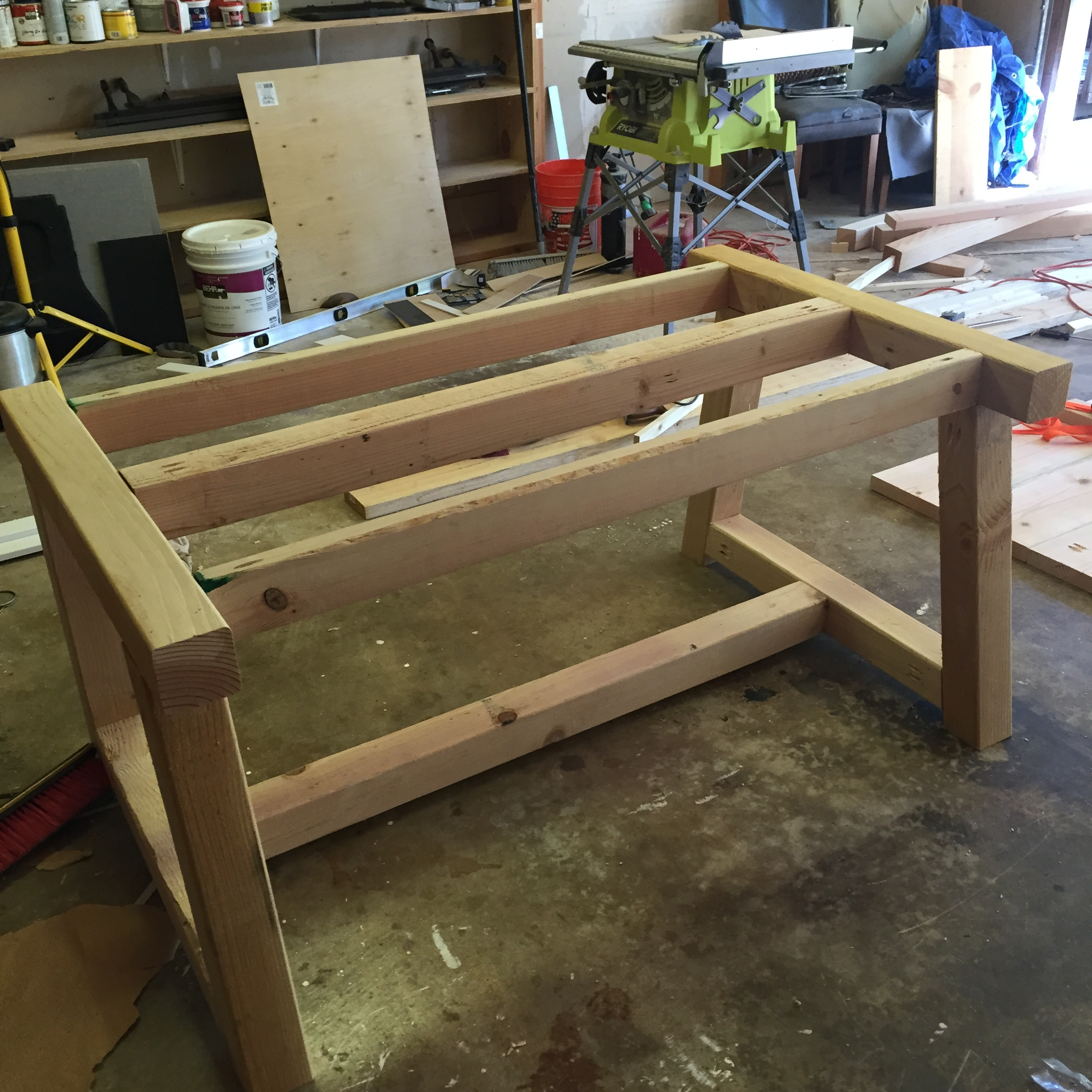 Once the top 2x4's are attached, we flipped the table over and attached the bottom 4x4