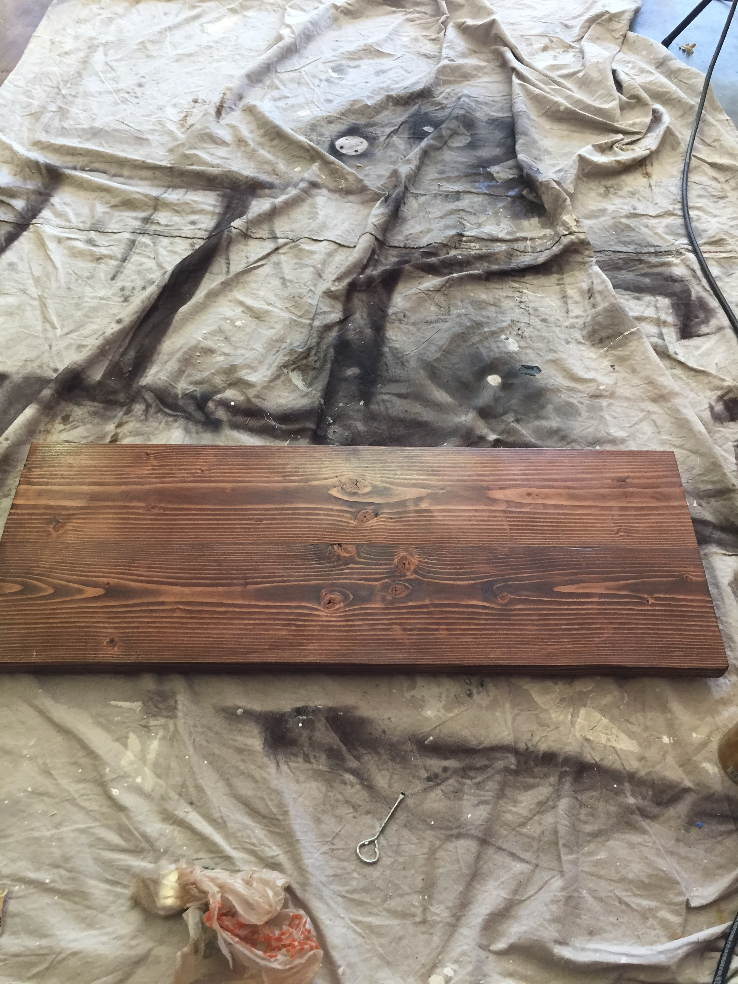 Next comes the sanding. Be sure to sand the table top to desired smoothness with various grits of sand paper.  Then use Special Walnut Stain (my favorite!)to stain the top and bottom.   After the stain dried we applied 2 coats of clear polyurethane to seal it.