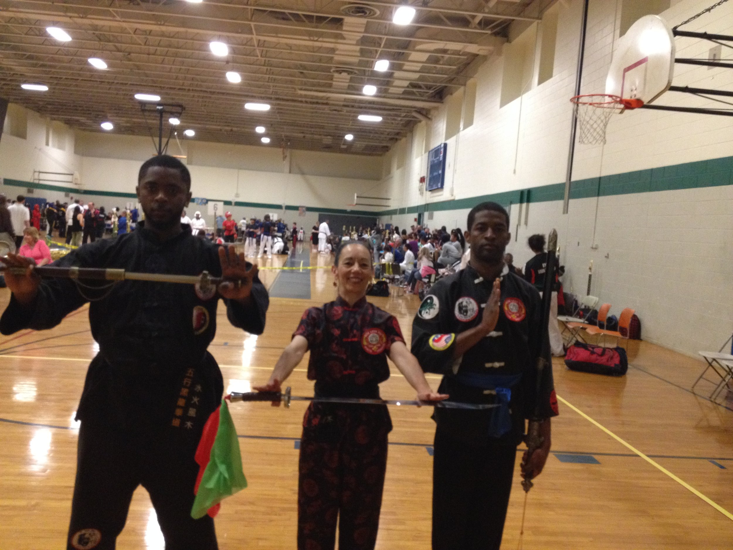 Dahmeen, Sharon and Gabe after Sharon at World Martial Arts Federation Karate Kung Fu Tournament - Sharon 1st Place and Dahmeen 2d Place Advanced Weapons.  Gabe 1st place Intermediate Weapons.jpg