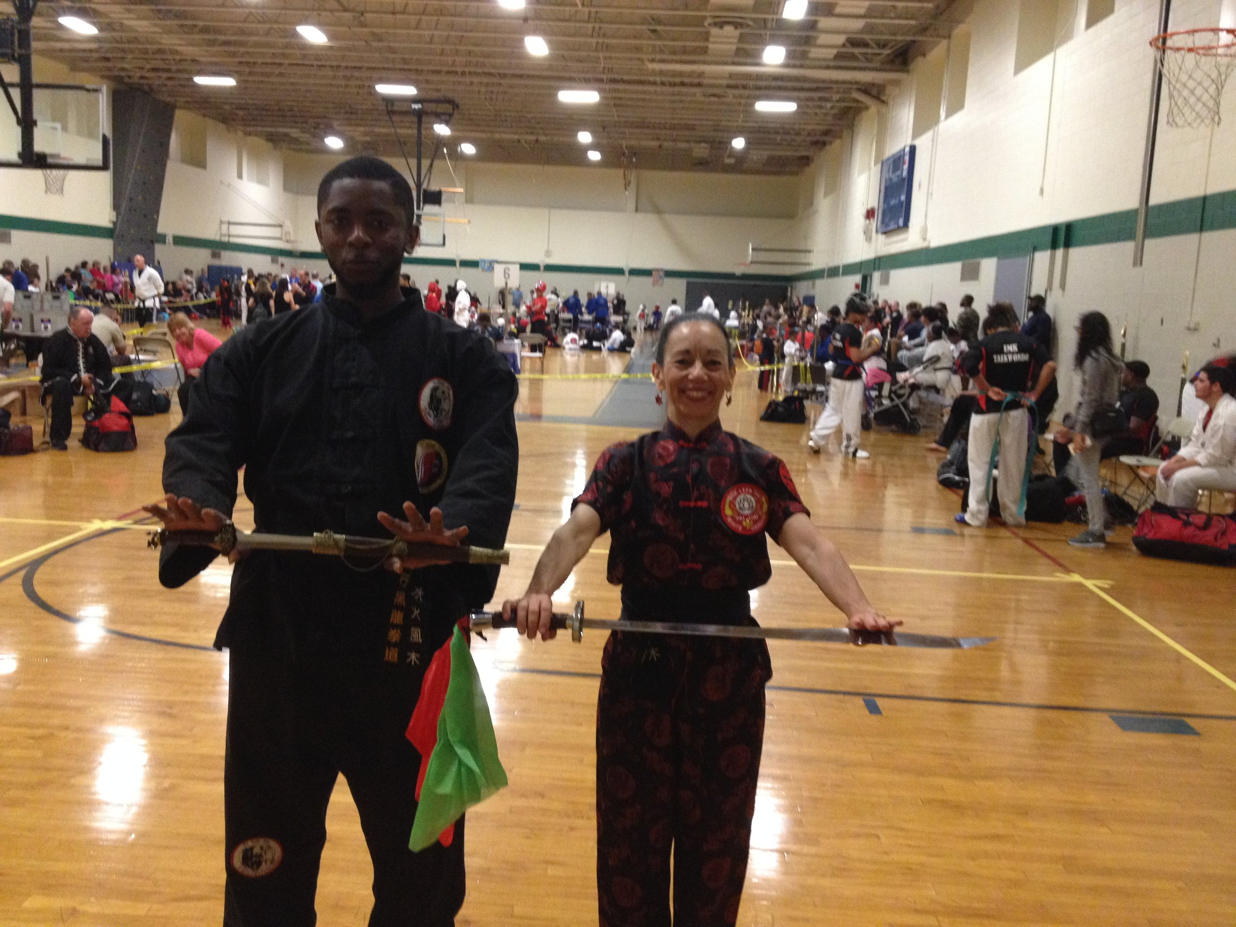 Dahmeen and Sharon after Sharon at World Martial Arts Federation Karate Kung Fu Tournament - 1st Place Sharon.  2d Place Dahmeen Advanced Weapons.jpg