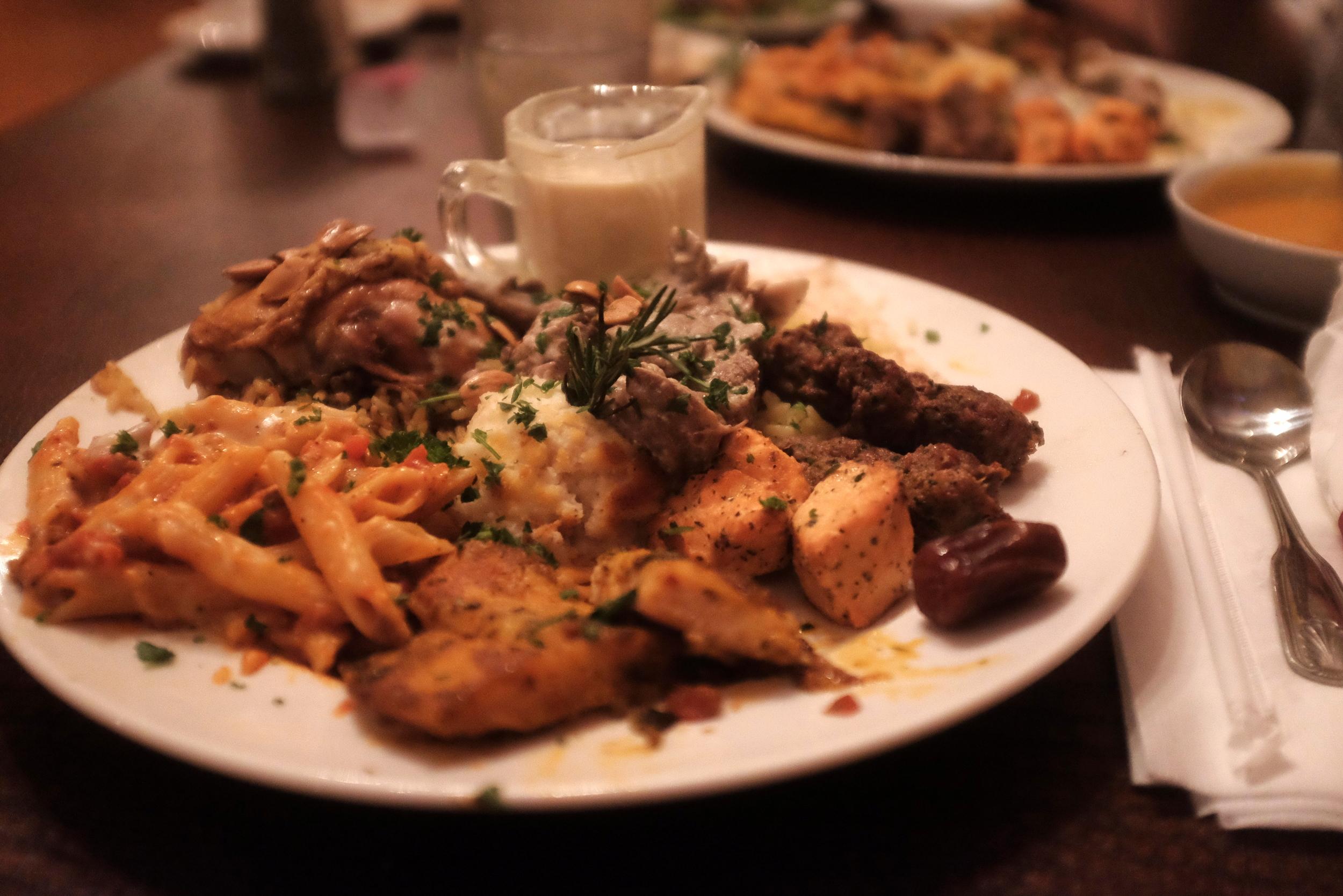 And what a feast it is: Maklouba, Mansaf, Potatoes, Pasta, Kofta, Kebab, and fish!