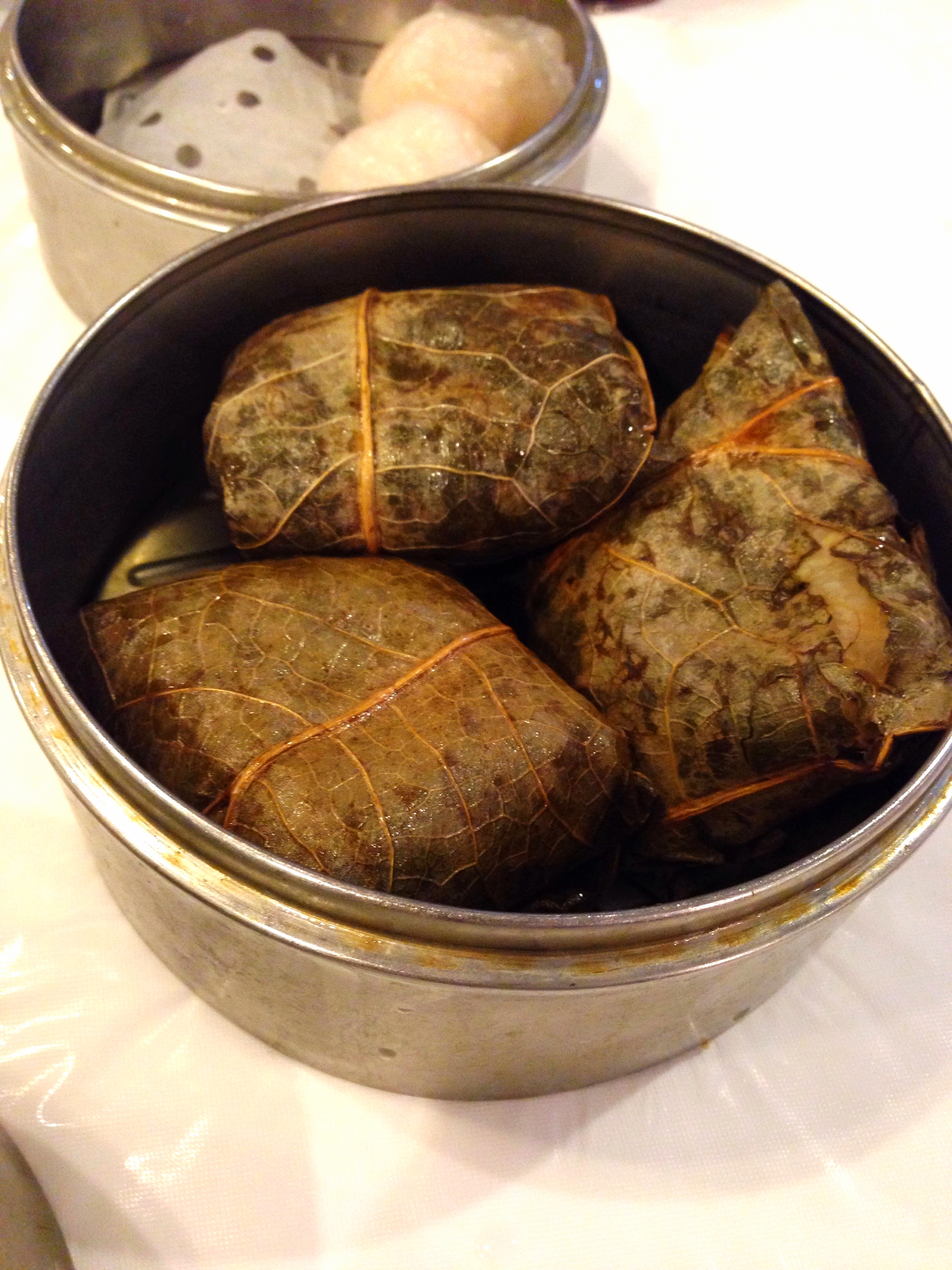 """Lo mai gai"" This meat stuffed rice is wrapped in lotus leaves and steamed."