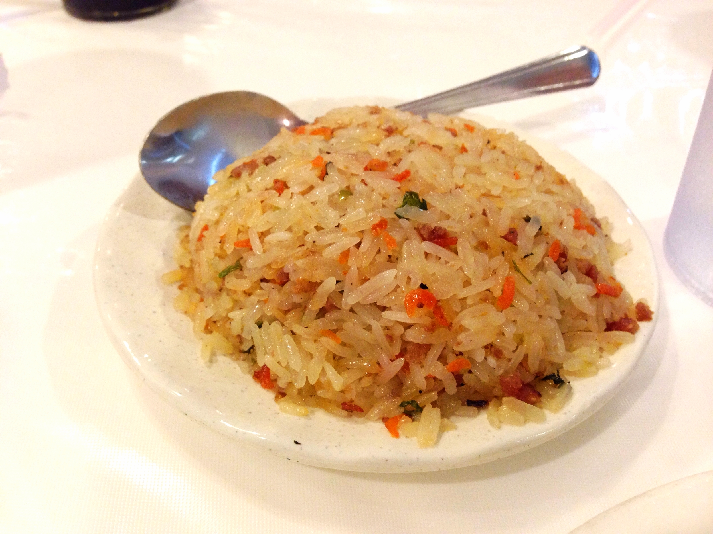 "Cantonese style fried rice is one of this rice-loving Cajun's all time favorites.  It has a ""dry"" texture to it that is delicious."