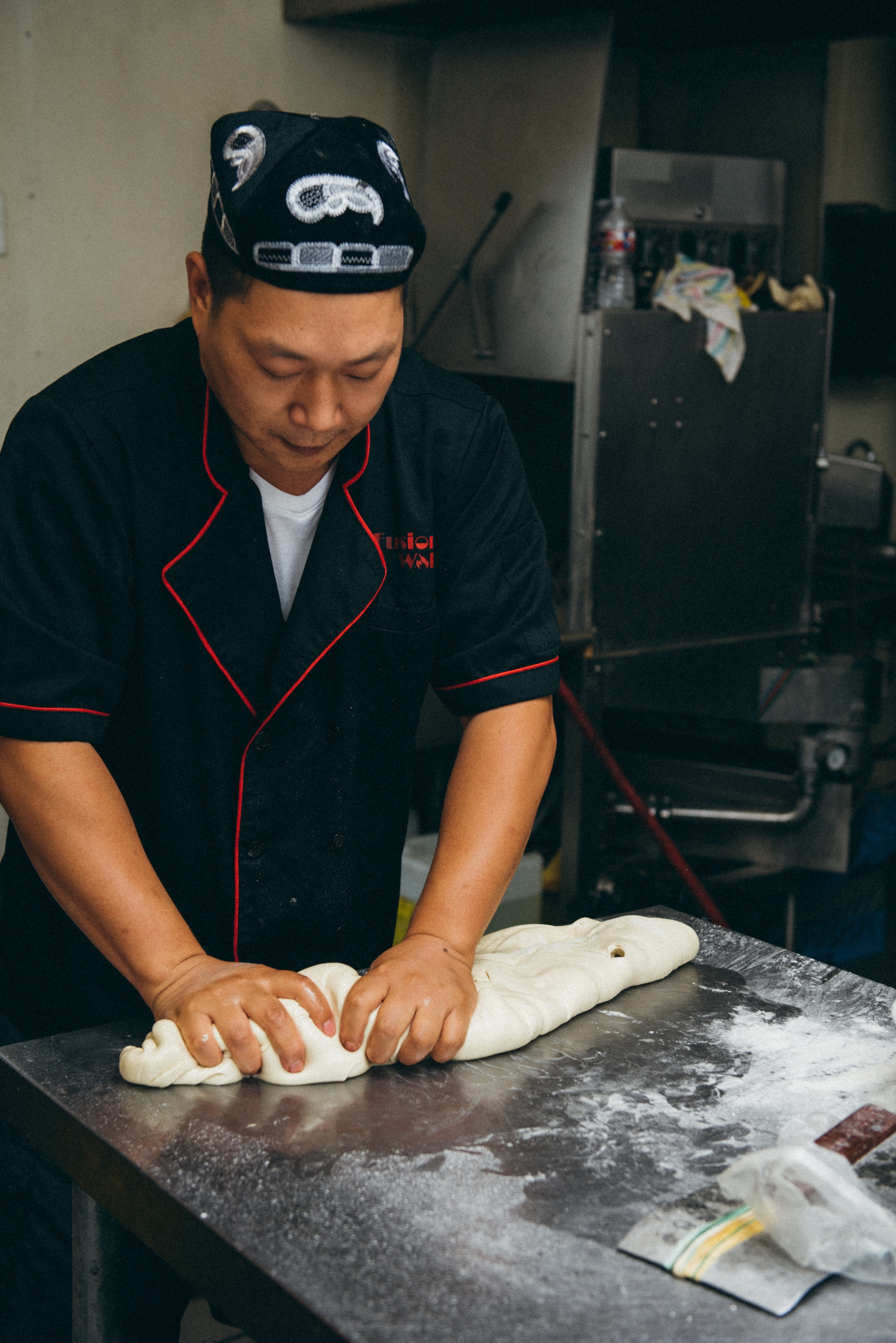 2. Noodles begin as a lump of dough that is made fresh every day.