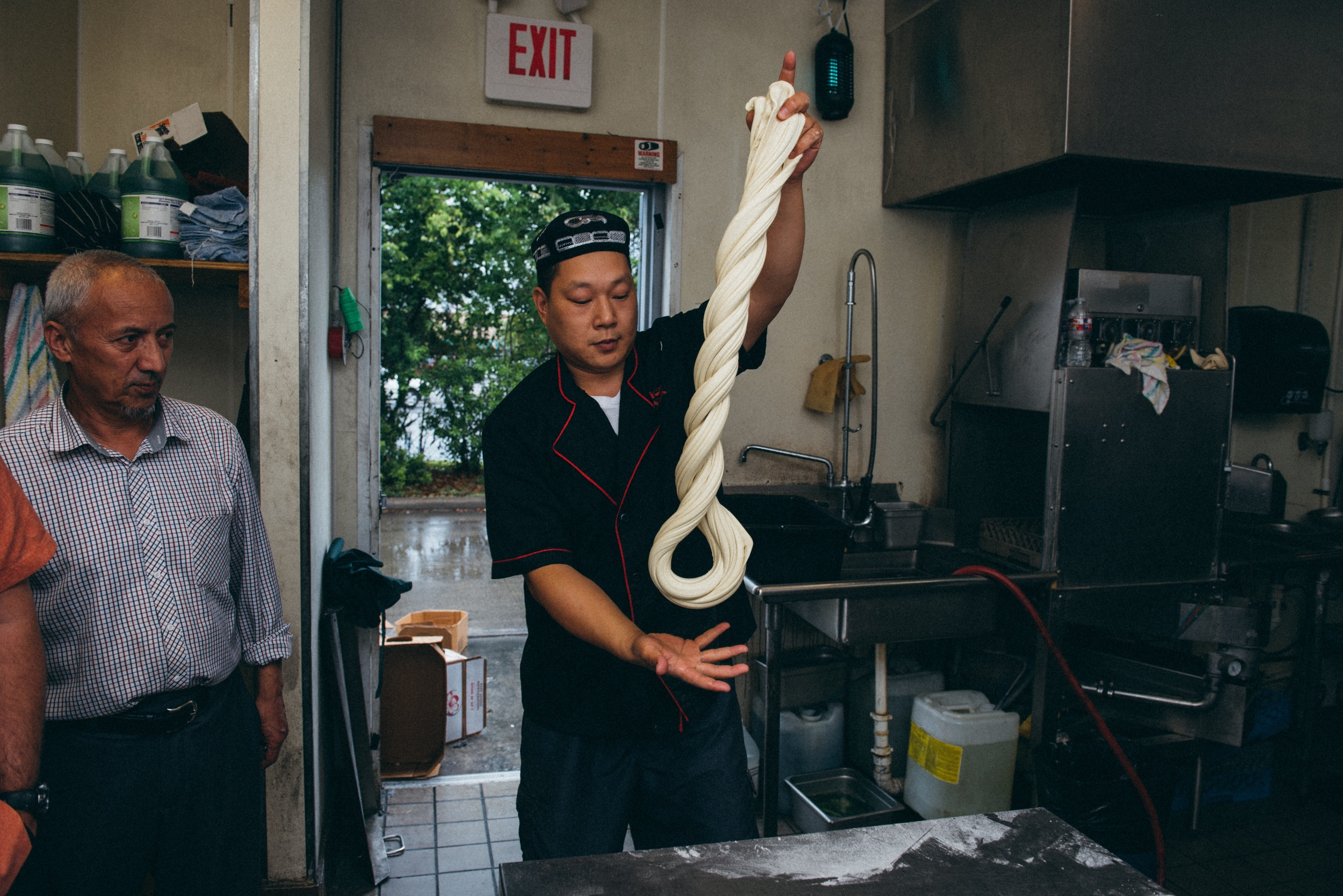 4.  The twisting and stretching causes a chemical reaction which gives the dough more elasticity and strength.