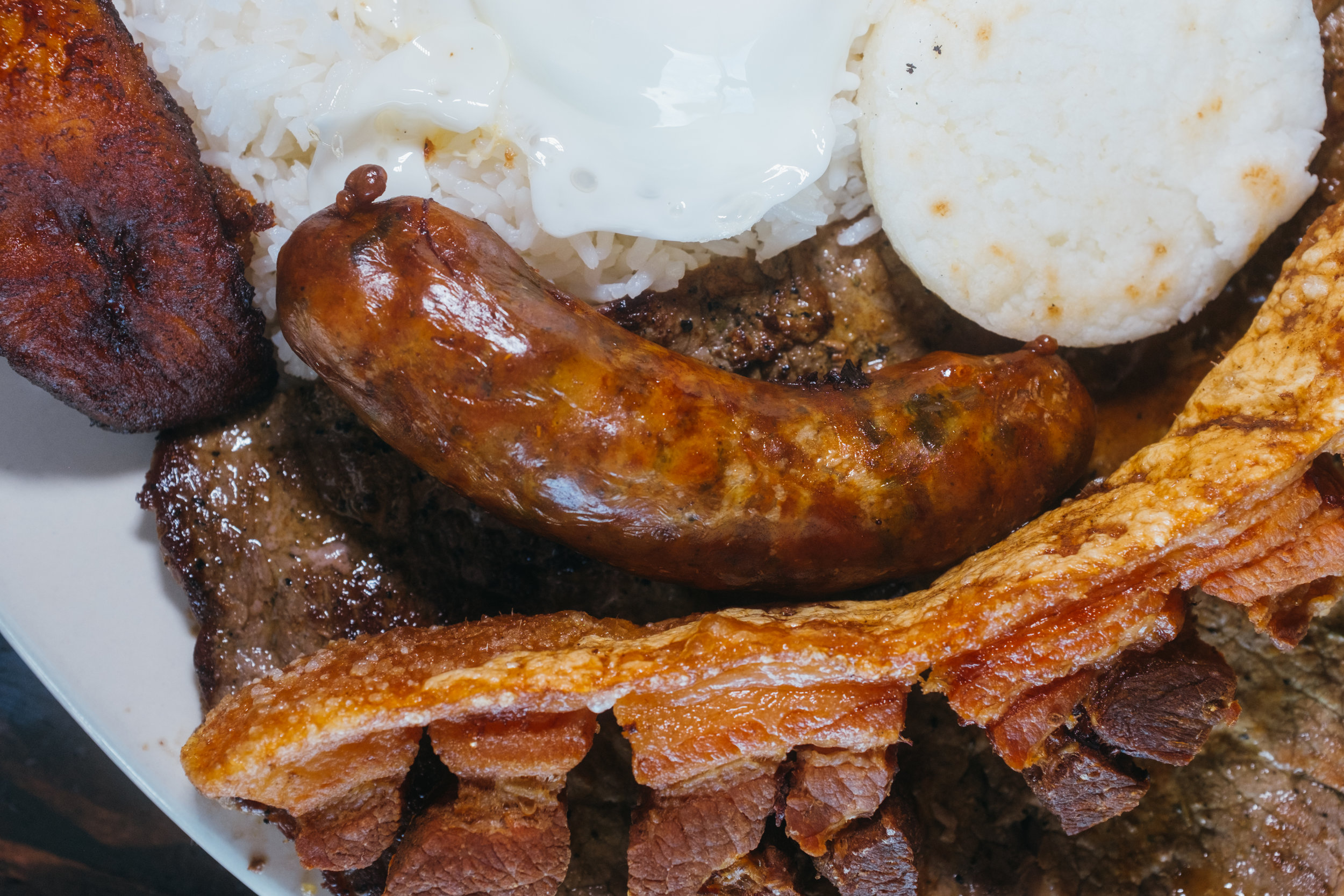 Chicharrón (deep fried bacon with all the fat) and chorizo (sausage)