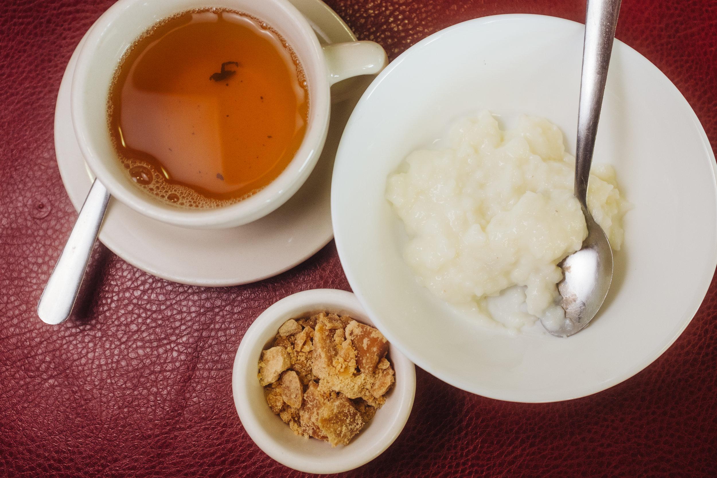 Green Tea, Qand (tea soaked sugar blocks), and Shir Berenj (Rice pudding)