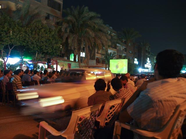 This is how you watch the soccer match in Egypt, in a street cafe