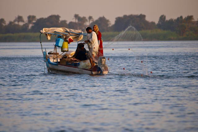A family fishes on the Nile