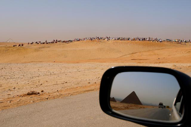 We often see the pyramids without all of the tourists.  Here is the gaggle.