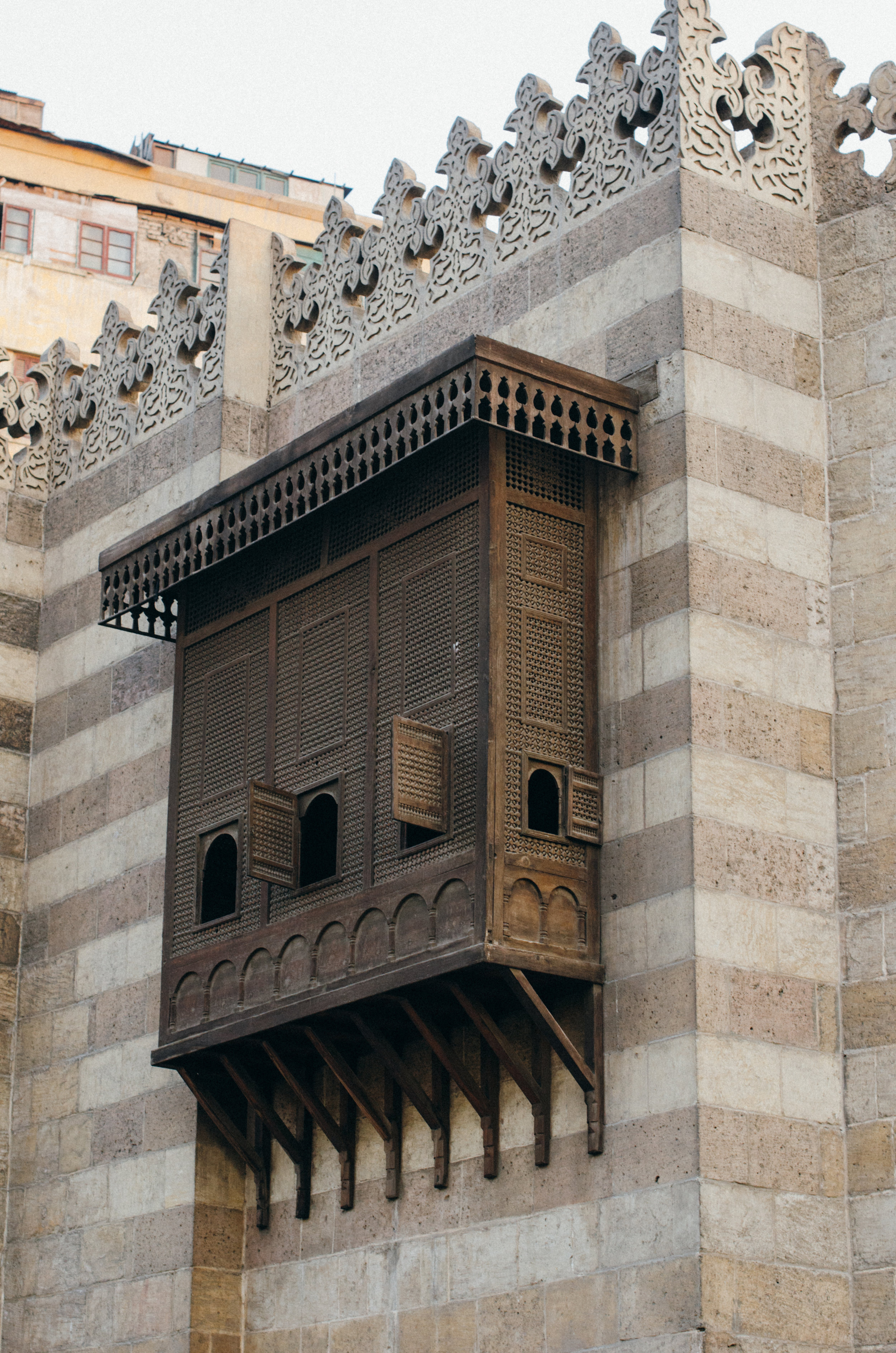 Classic windows like these are called Mashrabiya.  They allowed women to hear and see what was happening on the street while protecting their privacy