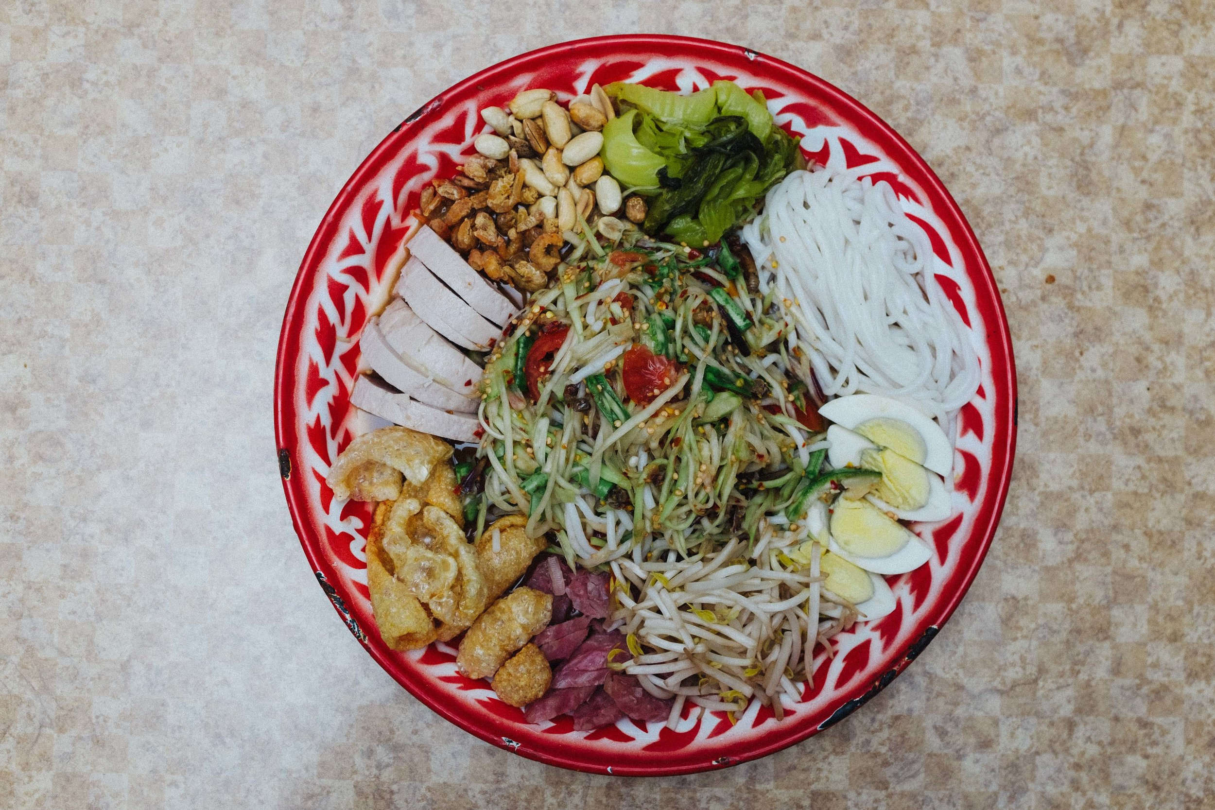 Som Tum Tad: Papaya Salad with assorted finger foods such as cracklins