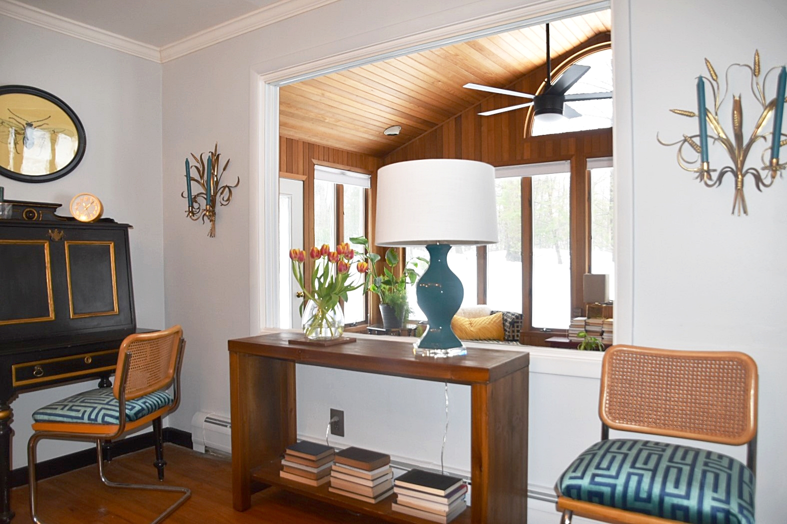 Adding a large lamp that you would normally place in a living room, immediately provides warmth.