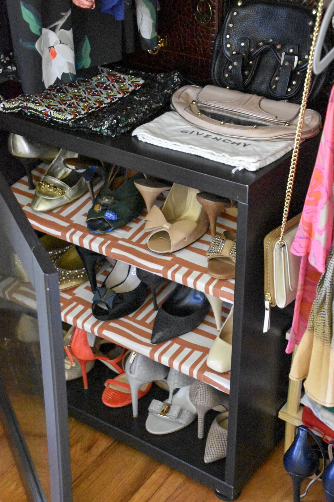 glass shoe cabinet with patterned shelves by the rath project