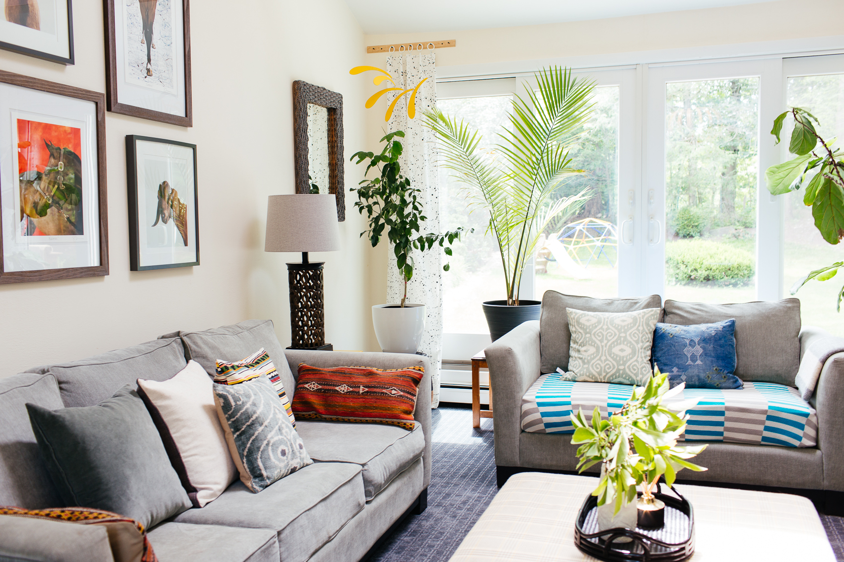 eclectic colorful patterned plant filled family room den therathproject