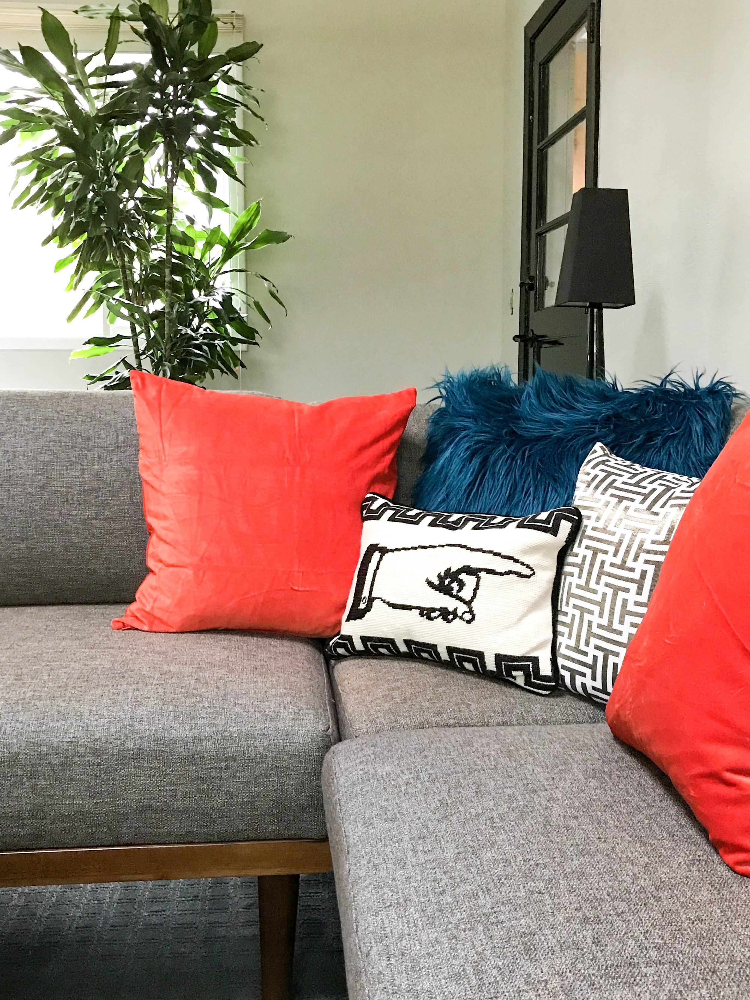 Raymour Soto Sectional with pops of color and additional texture with pillows!