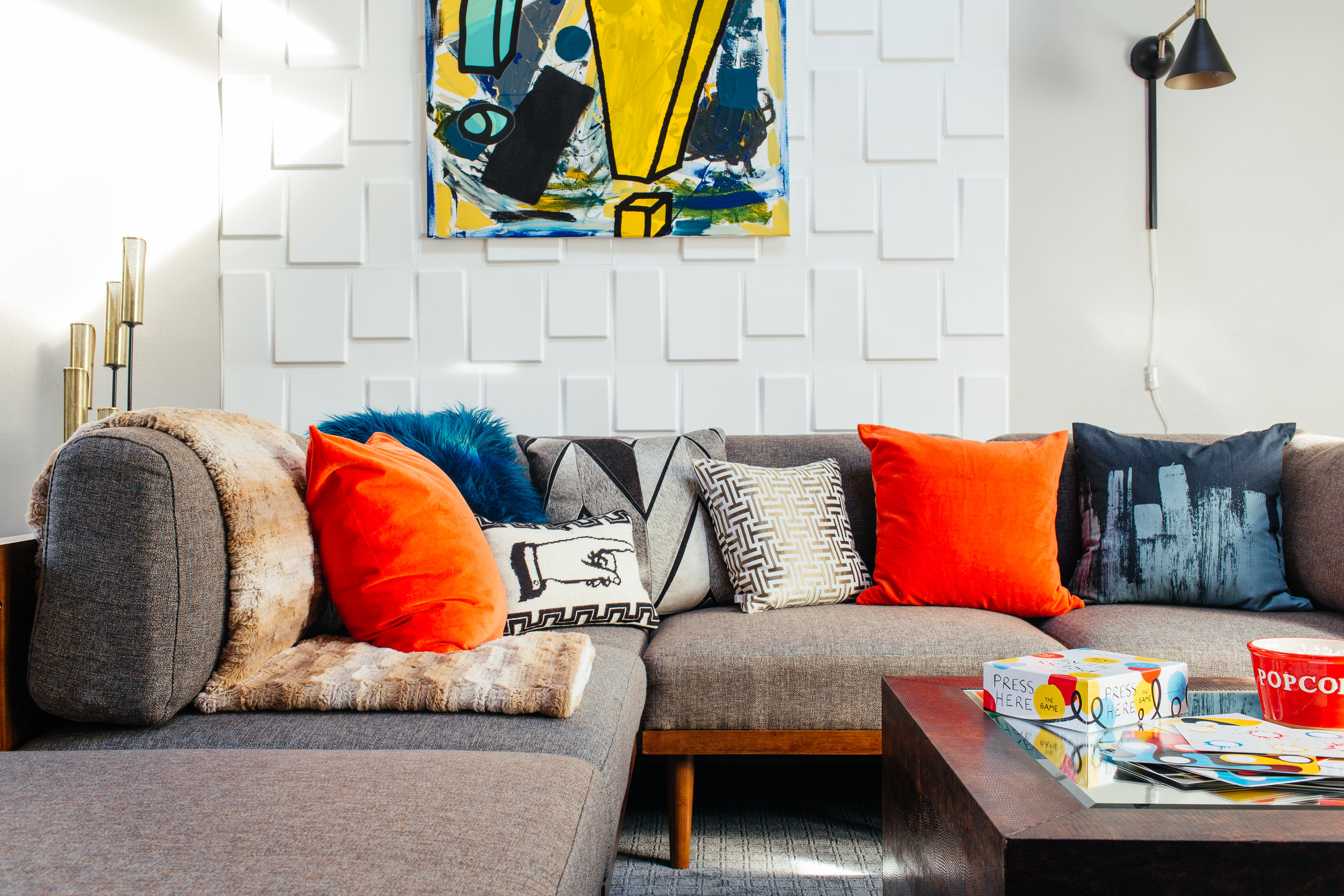 modern eclectic family room with textured wall and Raymour & Flanigan Soto sectional by the rath project