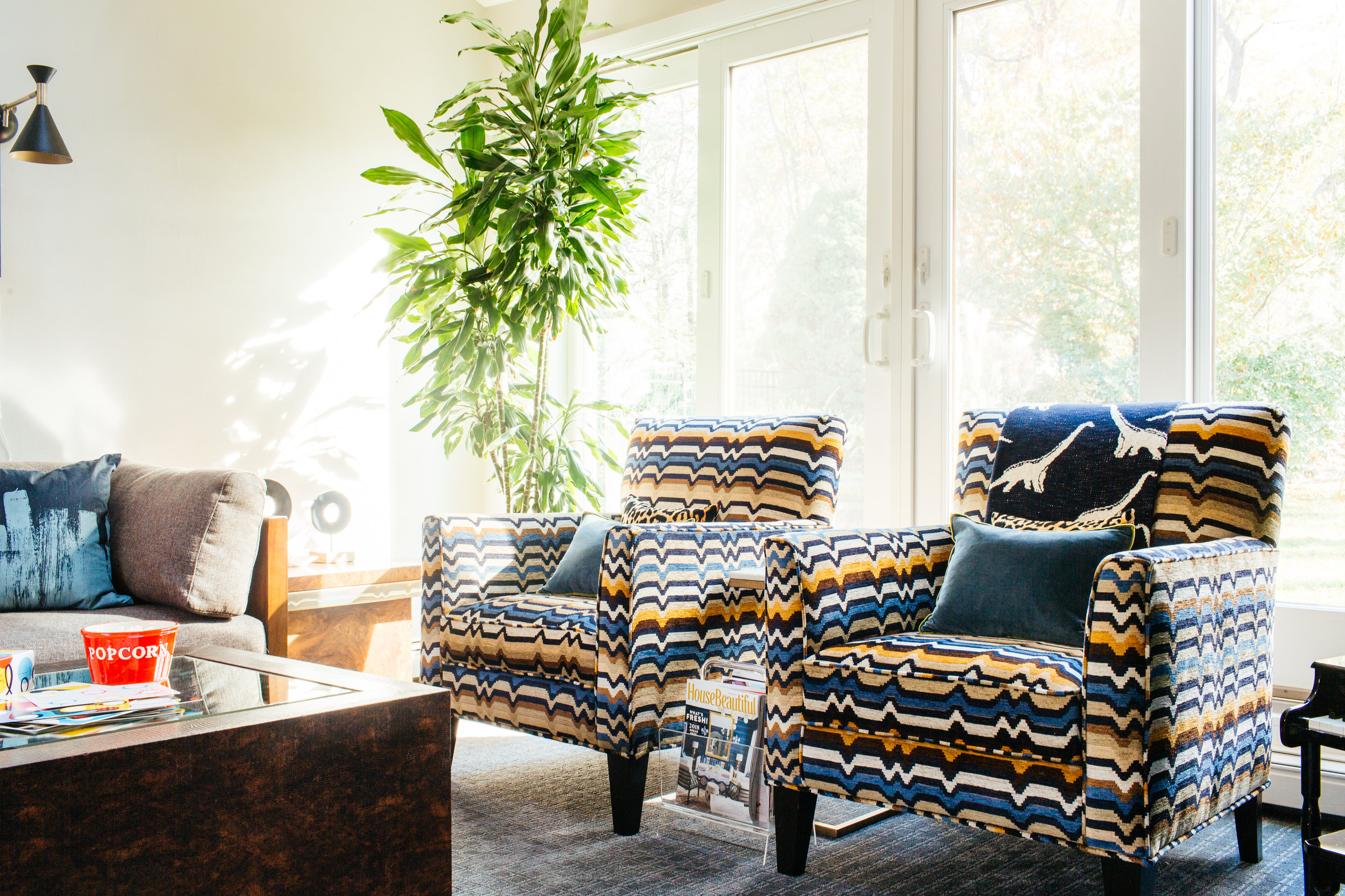 modern eclectic colorful family room design with multicolor chevron patterned Raymour & Flanigan Artemis chair by the rath project
