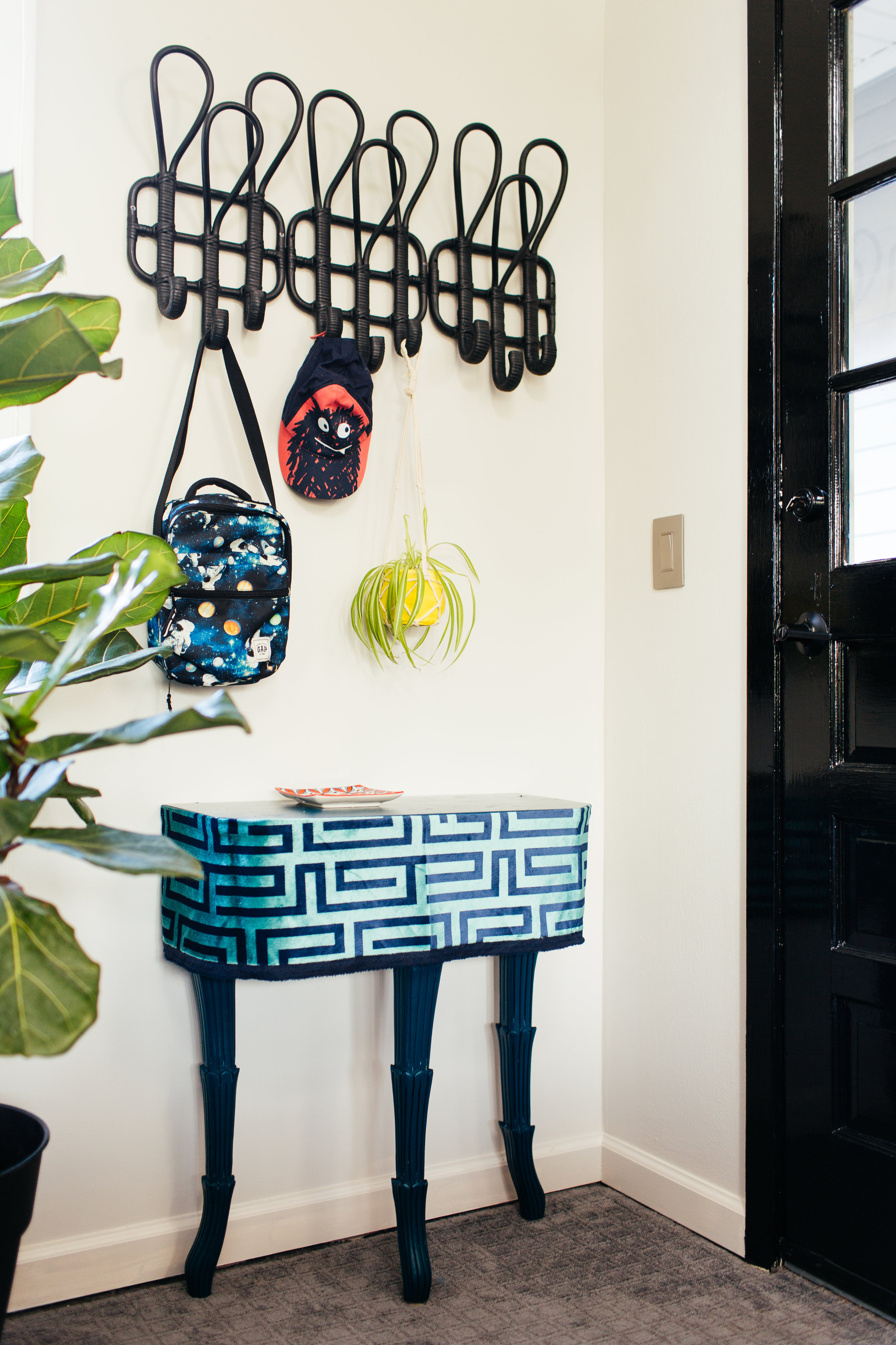 diy high gloss teal and greek key hall table in modern eclectic family room by the rath project