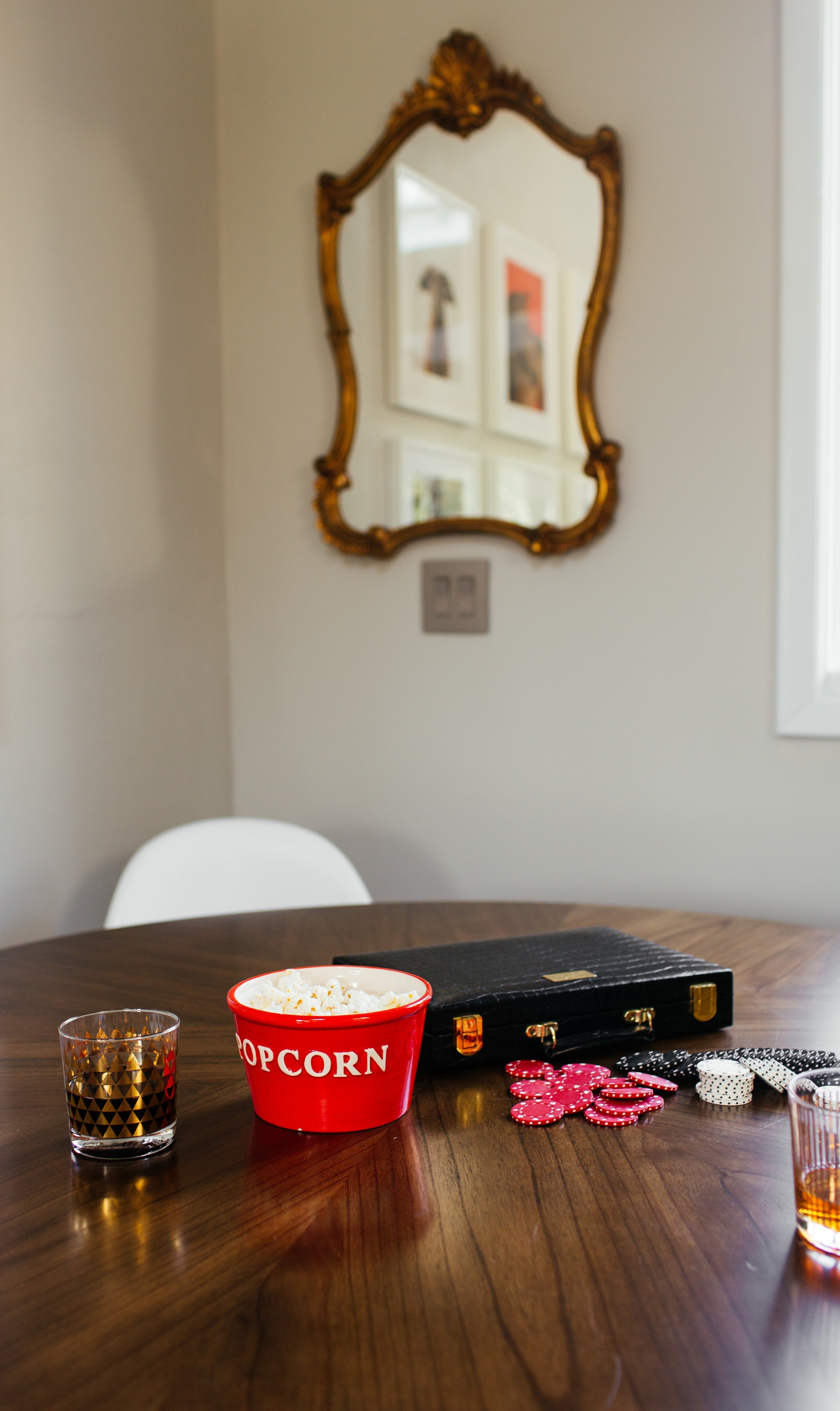 game table details in modern eclectic family room design by the rath project