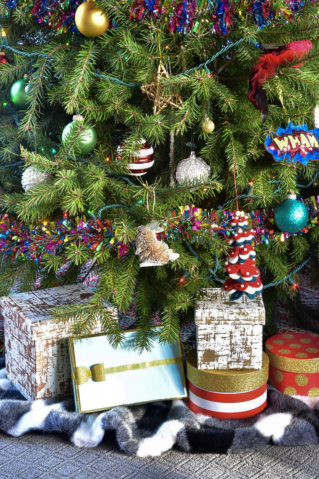 .Colorful Christmas tree with colorful boxed presents by the rath project