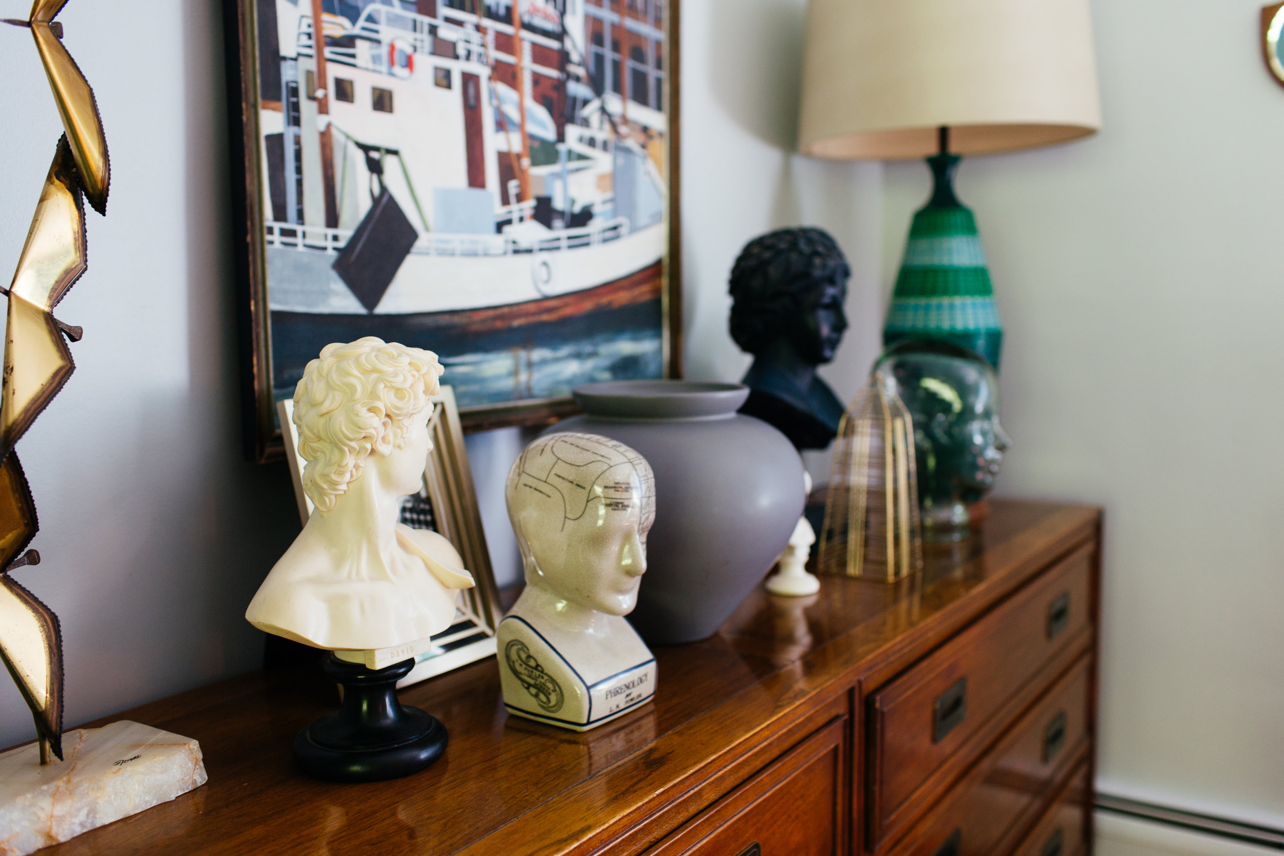 collection of busts in eclectic living room by the rath project