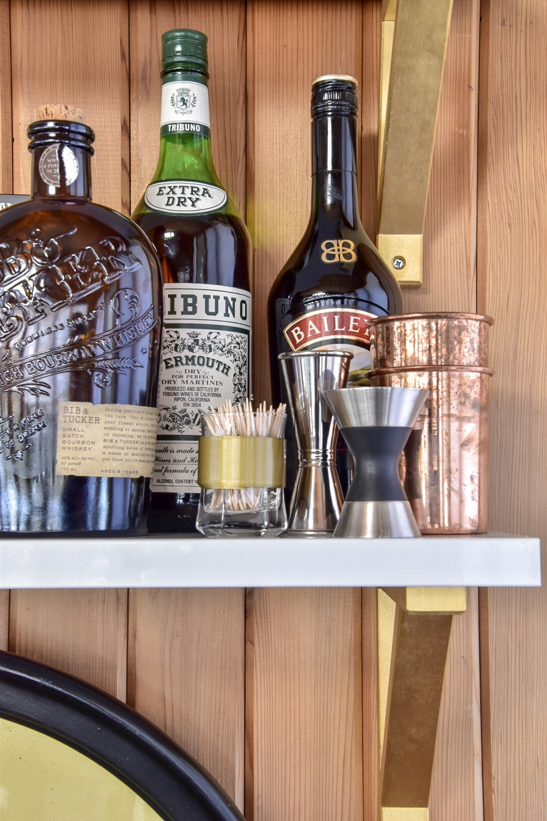 Eclectic Mid Century bar styling with groups and collections by The Rath Project
