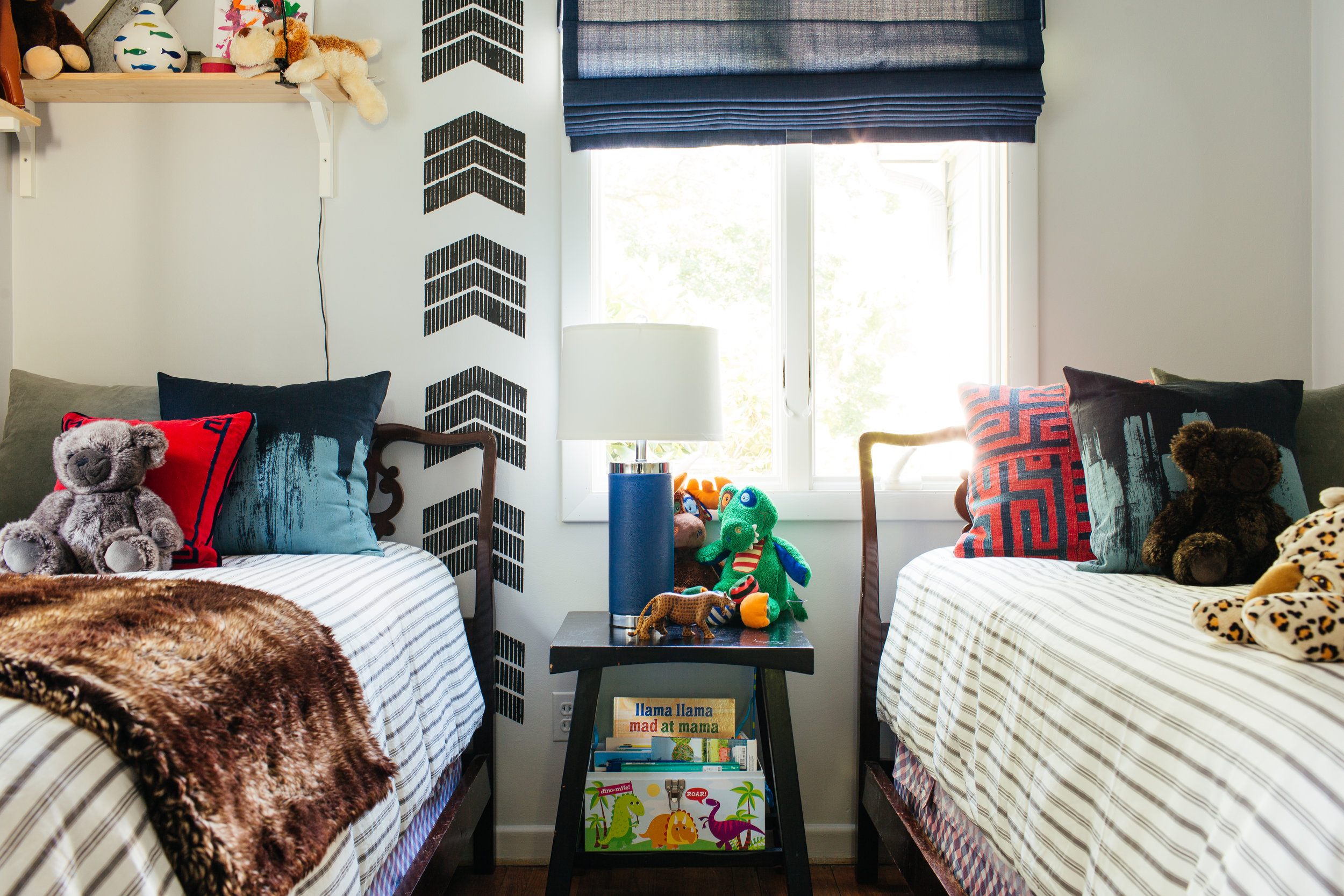 Kids collected eclectic bedroom with twin beds by the rath project