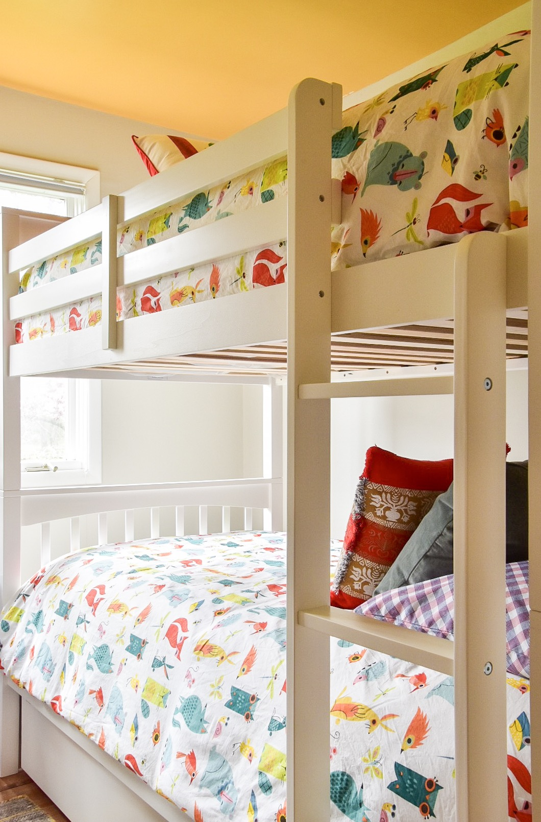 Bunk beds and Yellow painted ceiling in Kids Room Makeover by The Rath Project