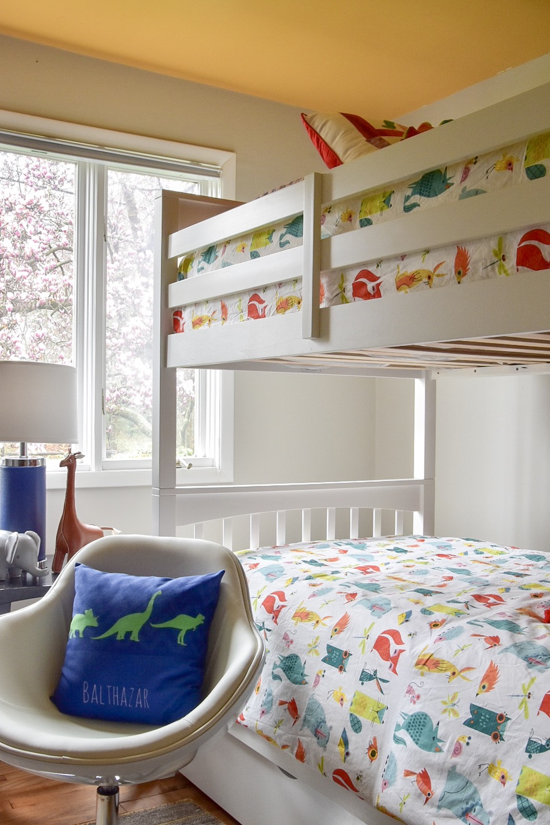 Yellow Painted Ceiling and bunk beds in colorful modern kids room by The Rath Project