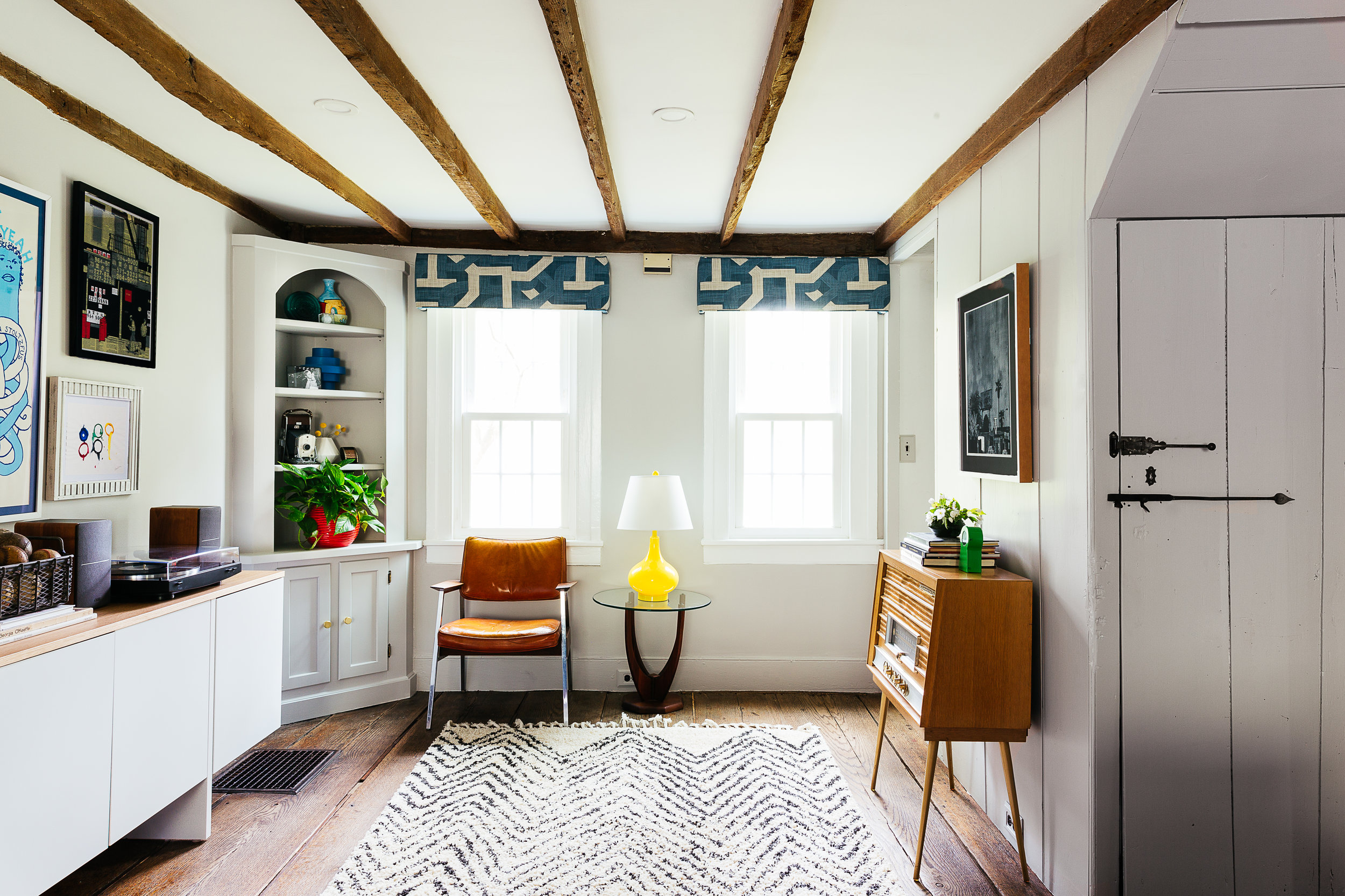 Antique farmhouse turned mid mod living room design by the rath project