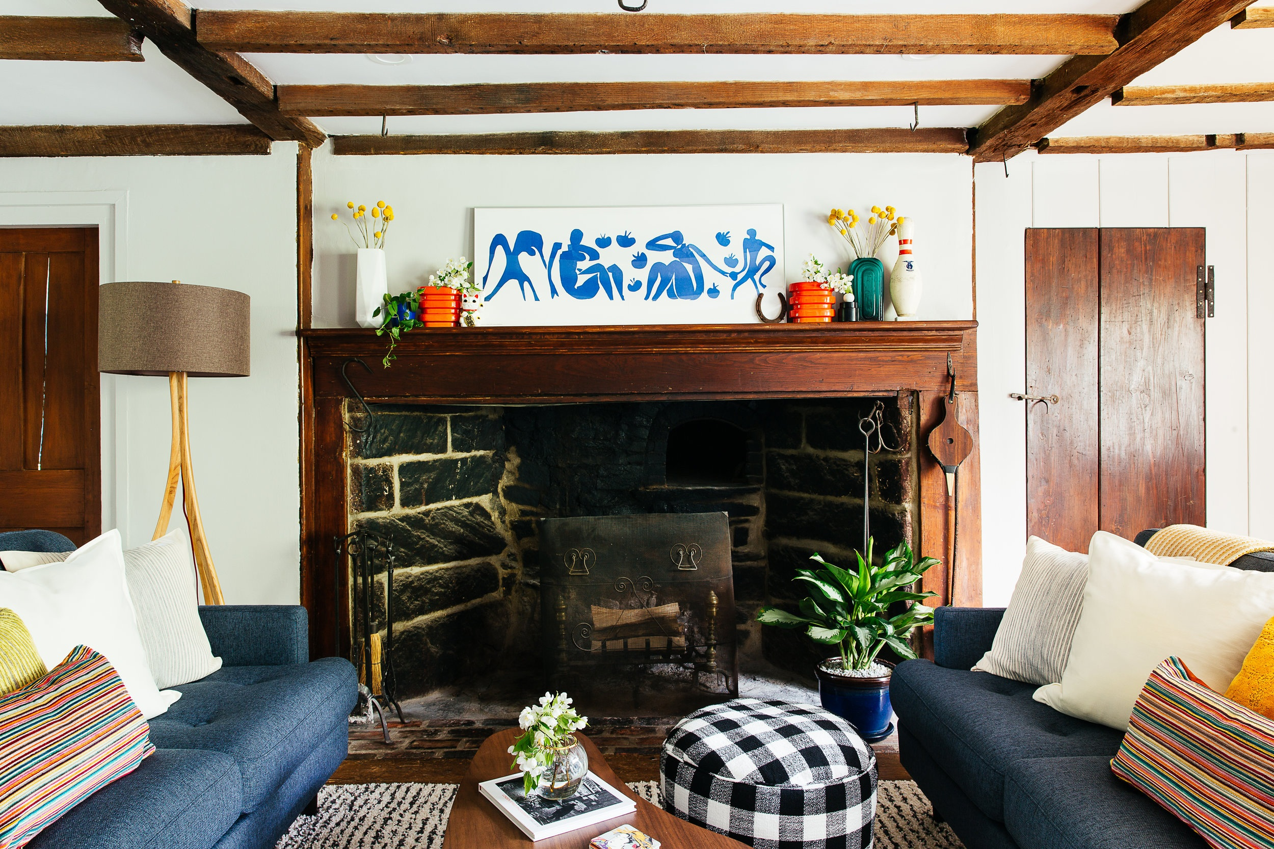 Antique+farmhouse+turned+mid+mod+living+room+design+with+double+sofa+in+front+of+1750%27s+fireplace+by+the+rath+project